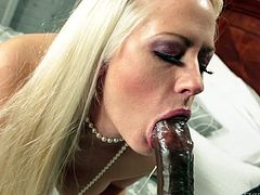 Holly Heart is hot blonde with nice tits, who loves to suck it black. There she was, only in her stockings and high heels, playing with her twat and tits, to lure Moe's cock into her playground. While she displayed her hole to Moe, he got hard enough to fill Holly's mouth and throat with his choco-pole!