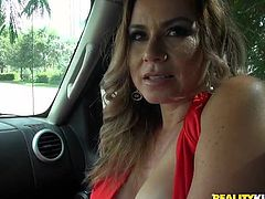 This hot milf gets picked up and lifts up her dress in the car for a little bit of money. She is horny and wants to fuck, so the new pair head back to his place, where she can suck on his throbbing erection.