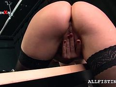 Redhead mature lesbo in stockings gets cunt fisted deep from behind