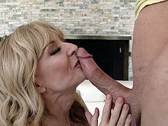 Nina is a versed mature woman, who knows how to seduce a guy. Watch the blonde-haired versed slut, exercising her charm on a young stud, who gets excited by her sensual movements. The bitch gets banged from behind, after offering an inciting blowjob! Don't miss the details...