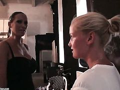 Blonde Kathia Nobili with massive tits and Mandy Bright kill time playing with each others snatch