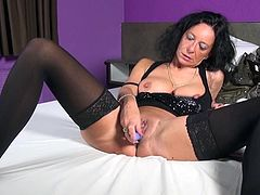 Wanna take a look at a brunette mature lady's intimacy? Go ahead and see slutty Elisa, playing with her horny pussy in bed. The lusty woman wears high heels, stockings and a nice sexy top, which she eventually removes, to show off her lovely big tits to the camera... Watch the bitch using a dildo.