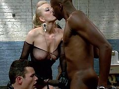 Cheery is so cruel and mean. Tonight she is going to make her little white bitch slave do something very humiliating. She makes him get on his knees in the sex dungeon and suck on a big black cock. She kisses the black hunk and the bisexual slave sucks black meat.