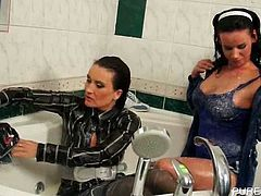 Sexy lesbos taking off their wet and messy clothes in bathtub