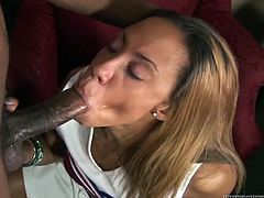 Ebony cheerleader enjoys licking and swallowing big black cock