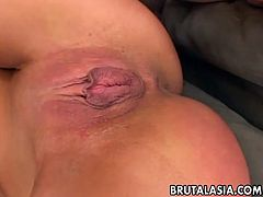 Slutty Asian bitch is deepthroating the two hot and hard cocks and she wants more so she gets more. The dudes doggy style her and spank that oriental ass.