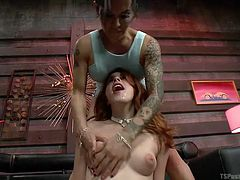 Sexy slut Bella bends over, so her amazing looking transsexual girlfriend can play with her ass and sweet pussy. The naughty slut is on her knees in front of the luscious tranny, ready to suck on her thick cock.