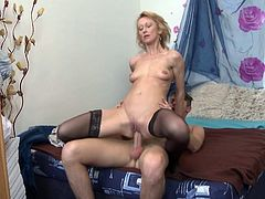 Are you easily turned on by the sight of mature versed ladies, that do their best to entertain their younger partners? Natali is a slim blonde-haired milf, with small tits and an open attitude. She's very camera friendly and loves the reverse cowgirl position. See the bitch sucking cock down to the balls.