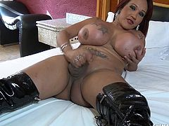 Shayanne loves to have a good time. She rubs her dick and shows off her sexy body, as she lies naked on her bed. Watch her shake those big ass and pinch her huge, tattooed boobs, as she bites on a peach. She does not let anything come between herself and the fun she can have.