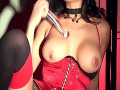 Exotic seductress Gianna is back in another sizzling black and red scene. Wearing a gorgeous red satin corset and black and red Cuban heel stockings Gianna uses her fingers and solid glass rod to climax.