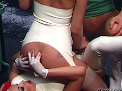 Dressed in head to foot white latex, these lesbian bitches show you a thing or two about how to climax. They soon require some male dominance, then this scene really is smoking!