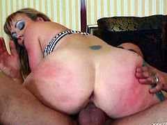 Tattooed MILF with big tits giving superb blowjob before getting hammered doggystyle