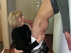 This horny mature women cannot wait to get hands on her younger partner's hot cock, and unzips his pants right on the hall next the door way. She seems very excited and available. She's got short blonde hair and dark red polished nails. Watch her down on knees sucking dick with frenzy...