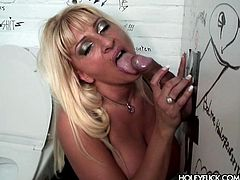BJ from a buxom blonde at the gloryhole makes his cock cum