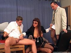 Hardcore gangbang in an office for a dirty slut in stockings