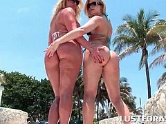 Huge ass trashy blondes flashing sexy parts at the beach