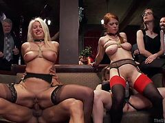 Horny lesbians are dominated and humiliated in front of everyone. The busty ladies wear collars and are rope bonded. Some wear corsets and strap on outfits. Click to watch slutty Aiden riding a cock from the reverse cowgirl position, while a foxy redhead is fucked hard with a strap on. Don't miss the details!
