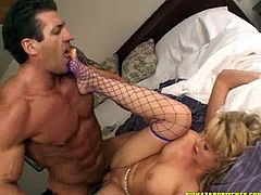 Horny blonde cougar in fishnet stocking giving her horny guy blowjob before getting her pussy pounded hardcore missionary