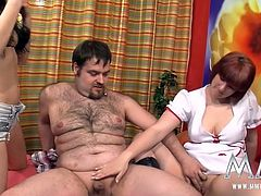 Young brunette and mature red head give blowjob to one guy