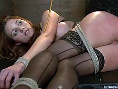 Bondageable redhead in stockings Kenzie Vaughn gets fingered hard