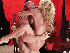Cherie Deville with massive melons is in heaven fucking with hard dicked dude Johnny Sins