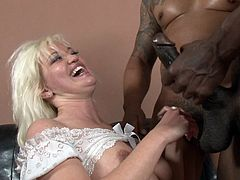 Salacious blonde with big boobs enjoying an interracial threesome