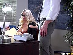 Busty blonde office lady keeps a cock at hand, while she gets too stressed, working long hours. She handles the cock and keeps her big boobs uncovered, so that it stays up and hard. However, the boner wants to find some wet warm hole, and Johnny is groping and licking it up, before banging Julie from behind.