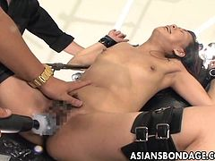 Asian whore is tied up and gets her wet pussy fucked with all kinds of sex machines. She has an orgasm after ogasm and her pussy is oozing with her cunt juices.