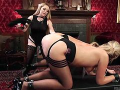 Two super hot blondes are tied up like bitches, since they are just mere minions to their dominating mistress. Brutal blonde domina enjoys every second of whipping their asses with her BDSM tools and the sluts can't scream, as they are mouth gagged. Sadistic lady also teased their pussies with beating.