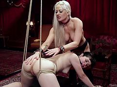 Sexy blonde Holly is having a tremendous sex with Karlo. While she's getting nailed in sideways, Yhivi, the small tittied brunette servant in chains comes in. Karlo and Holly stop fucking and start to play with Yhivi. They whip her ass, rope tied her and getting ready for more kinky fun. Keep watching!