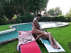 Sheila Grant with gigantic breasts and bald muff has a great time touching s honeypot