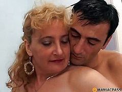 The guy strokes her hairy pussy