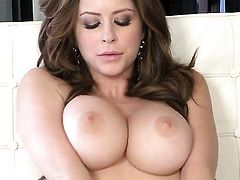 Emily Addison with giant hooters and shaved bush makes her sexual fantasies come true in solo action
