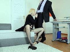 Nasty sexploitress wearing fishnets loves to dominate young man