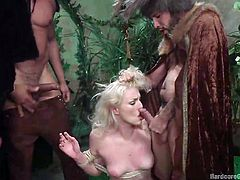 Do you like when horny ladies get taken by surprise and adapt to the situation? In this case, the blonde-haired bitch gets undressed, tied up with ropes and persuaded into sucking cocks from on knees position. A gang of four angry men circle the bitch and use her in an awfully manner, to satisfy their lust...