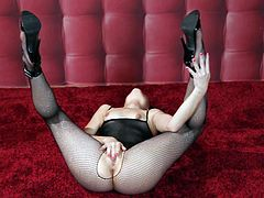 Leggy babe wearing body fishnet masturbates pussy in red room