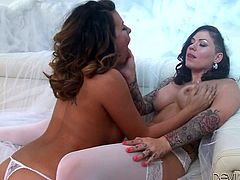 An attractive brunette babe joins slutty Danica in bed, spoiling the lazy bitch with passionate kisses and soft caresses. The atmosphere gets hotter, when they both open their bras and begin to suck each other's lovely tits. Click to watch the exciting scenes!