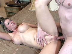 Busty Devon Lee gets a good hard poking from a hung guy