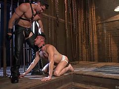 Do you think obedient gay guys are hot? Don't lose time and click to watch Leon, doing all the kinky things, Trenton tells him to do. First, he is persuaded into kissing the top of his master's boots, while being whipped with no mercy. Enjoy the blowjob inciting scene. Those leather pants are a huge turn on.