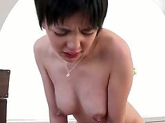 Nasty short haired jap girl Sakura Aida with amazing milking tits gets her nipples sucked and her bush fucked by horny older guy. He sticks his cock in her asian fuck hole over and over again.