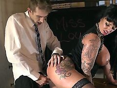 Kerry Louise is a tattooed milf with huge tits. She meets danny and starts sucking his big cock. In return he penetrates deep inside her yummy vagina.