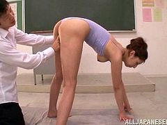 A teacher lays his Japanese student on the floor and drills her
