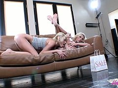 Backstage video featuring two salacious girlfriends on a couch
