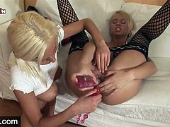 Two young blondes and lots of toys what else do you need these two young sluts love cunt and ass and get started straight away kissing each other they get their tits out and suck each others nipples hard making them so erect.
