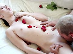 Handsome romantic dude pleases his tiny blondie with steamy cunnilingus