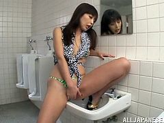 A naughty Japanese babe loves to play with her pussy. She knows exactly how to please herself and uses her imagination to go wild. The scenes filmed in bathroom are very inciting, as she climbs in the sink to masturbate with a lusty desire. The mirror plays an important role, enjoy the details!