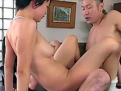 Short haired Japanese girl Sakura Aida with nice perky boobs gets her bush banged on the edge of a desk. She bounces on throbbing cock with her snow white panties on. Shes so horny!