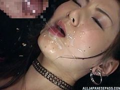 This dirty slut takes it hard from behind and while she is being pounded by a big hard cock, she gets another dick rubbed on her lips. She gets load after load of sticky sperm, plastered all over her beautiful Asian face.