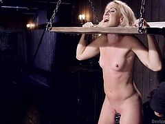 Isn't simply adorable, the way slutty bitches get punished and tortured? The way they scream, without any possible chance to get away from the hands of a severe executor? A naked blonde milf is the prisoner of a kinky bondage device, while her naughty cunt gets fingered and aroused with the help of a dildo. See!