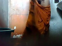 Skinny dark skinned amateur Indian woman flashes her small titties